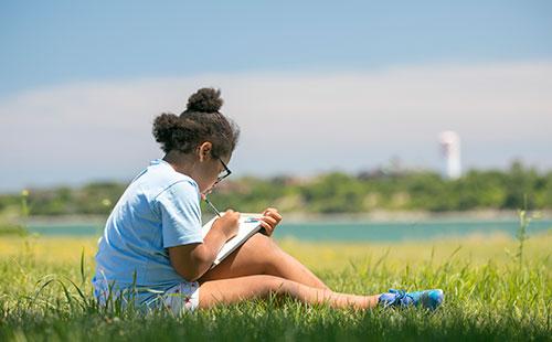 Spectacle Island girl working on homework
