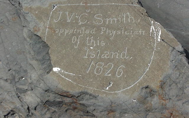 Engraving on white rock reads: J.V.C. Smith, appointed physician of this island. 1826.
